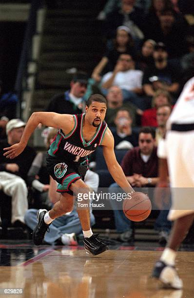 Mahmoud AbdulRauf of the Vancouver Grizzlies runs with the ball during the game against the Golden State Warriors at the Arena in Oakland California...
