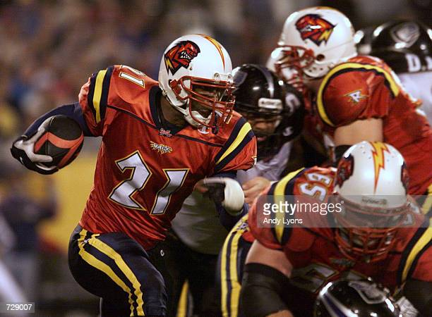 Michael Black of the Orlando Rage runs with the ball against the Chicago Enforcers during XFL opening night at the Citrus Bowl in Orlando Florida...