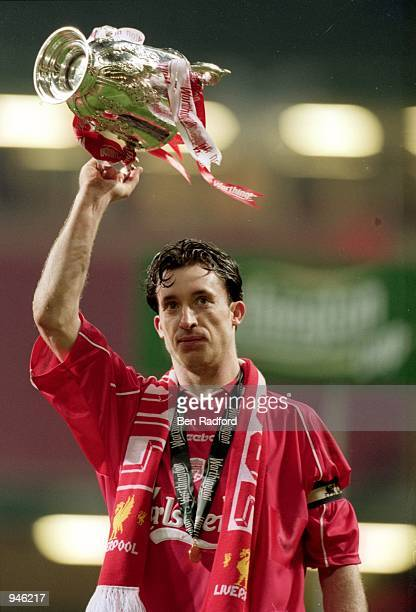 Robbie Fowler of Liverpool lifts the trophy after the Worthington Cup Final match against Birmingham City played at the Millennium Stadium in Cardiff...