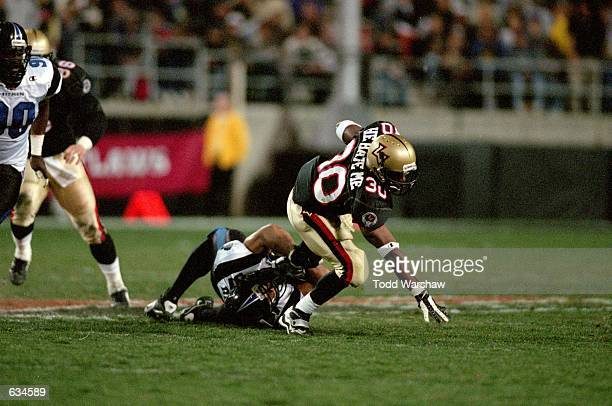 Rod Smart of the Las Vegas Outlaws gets tackled during the game against the New York/New Jersey Hitmen at the Sam Boyd Stadium in Las Vegas Nevada...