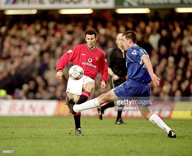 Ryan Giggs of Manchester United knocks the ball past John Terry of Chelsea during the FA Carling Premiership match played at Stamford Bridge in...