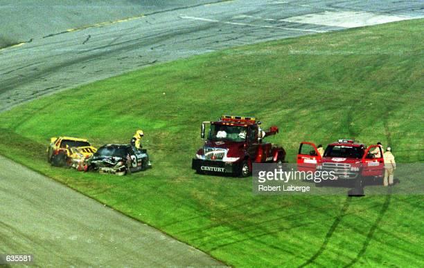 Saftey vehicles arrive on the scene of the crash involving Dale Earnhardt and Ken Schrader during the NASCAR Winston Cup Daytona 500 at the Daytona...