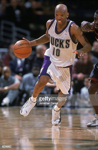 Sam Cassell of the Milwaukee Bucks runs with the ball during the game against the Philadelphia 76ers at the Bradley Center in Milwaukee Wisconsin The...