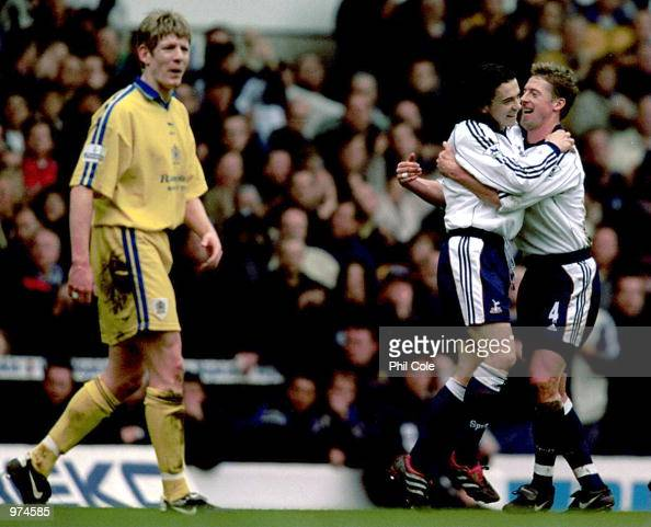 Simon Davies of Tottenham Hotspur is congratulated by team mate Steffen Freund after scoring during the AXA sponsored FA Cup Fifth Round match...