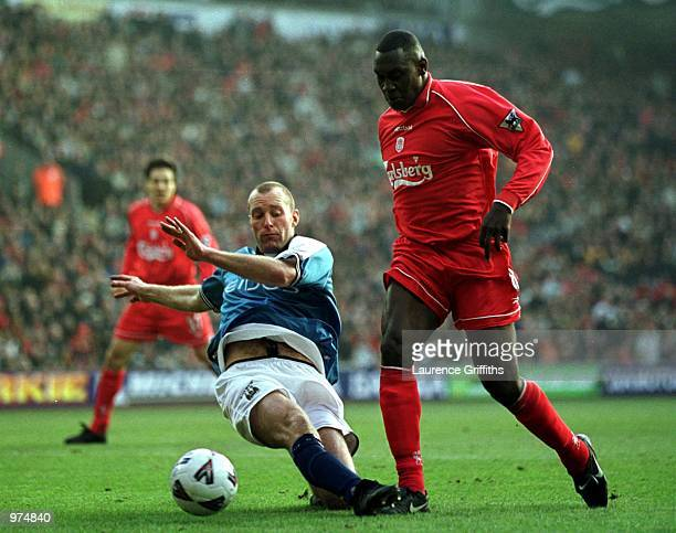 Spencer Prior of Man City tackles Emile Heskey of Liverpool during the Liverpool v Manchester City AXA FA Cup fifth round match at Anfield Liverpool...