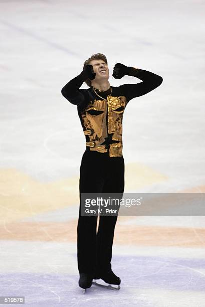 Alexei Yagudin of Russia celebrates after competing in the men's free program during the Salt Lake City Winter Olympic Games at the Salt Lake Ice...