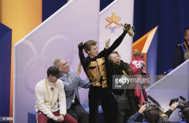 Alexei Yagudin of Russia celebrates his gold medal in the men's free program with his family and coach during the Salt Lake City Winter Olympic Games...