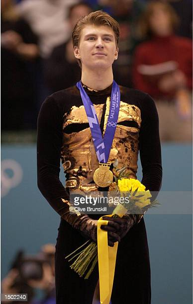 Alexei Yagudin of Russia receives his gold medal after competing in the men's free program during the Salt Lake City Winter Olympic Games at the Salt...