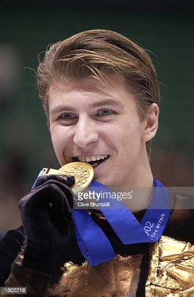 Alexei Yagudin of Russia receives his gold medal after the men's free program during the Salt Lake City Winter Olympic Games at the Salt Lake Ice...