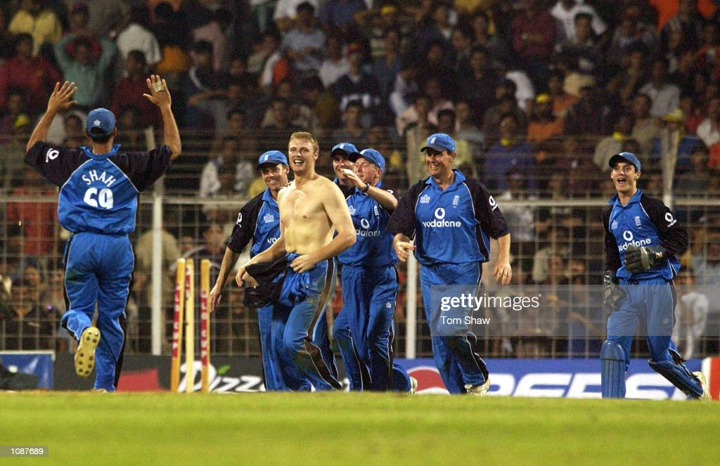 Andrew Flintoff of England celebrates with his shirt off after he took the final wicket to win the match and draw the series during the India v...