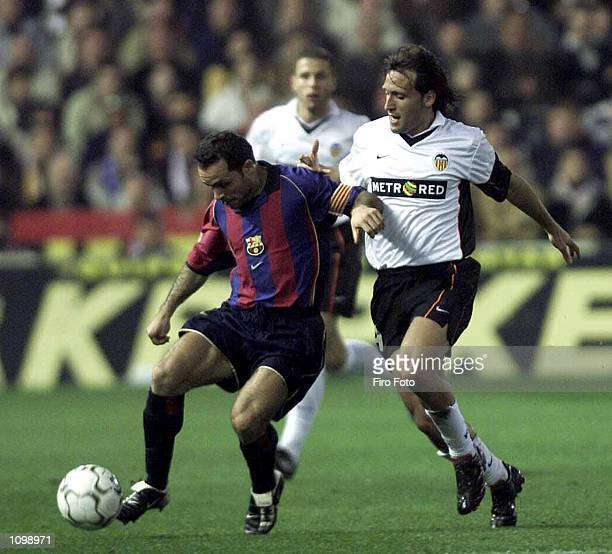 Barjuan Sergi of Barcelona and Francisco Rufete of Valencia in action during the Primera Liga match between Valencia and Barcelona played at Mestalla...