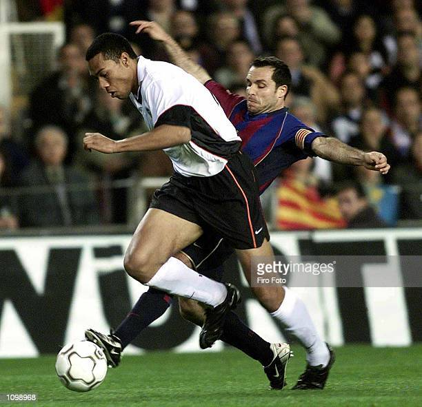 Barjuan Sergi of Barcelona and John Carew of Valencia in action during the Primera Liga match between Valencia and Barcelona played at Mestalla...