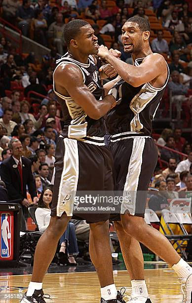 Center Tim Duncan and guard Stephen Jackson of the San Antonio Spurs celebrate during the NBA game against the Miami Heat at American Airlines Arena...
