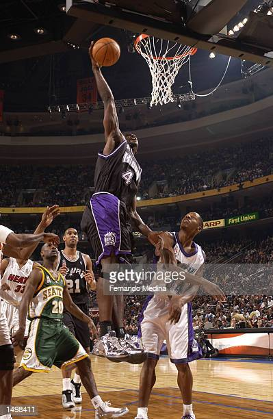 Chris Webber of the Sacramento Kings dunks during the 2002 NBA AllStar game at the First Union Center during the 2002 NBA AllStar Weekend in...