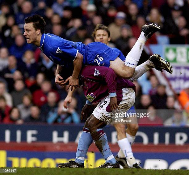 Darius Vassell of Aston clashes with John Terry of Chelsea during the Barclaycard Premiership match between Aston Villa and Chelsea at Villa Park...