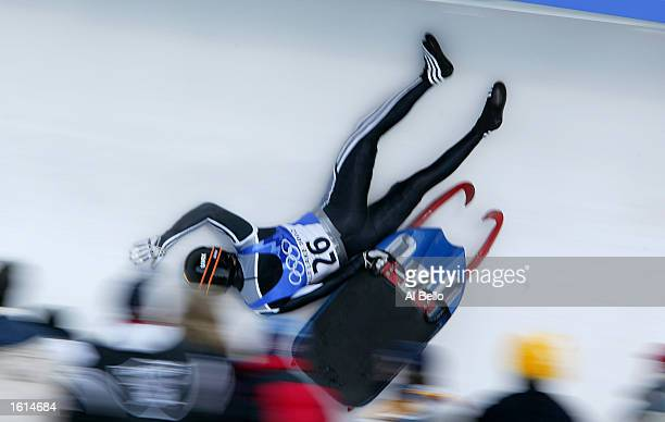 Eugen Radu of Romania crashes in the men's luge event during the Salt Lake City Winter Olympic Games at the Utah Olympic Park in Park City Utah...