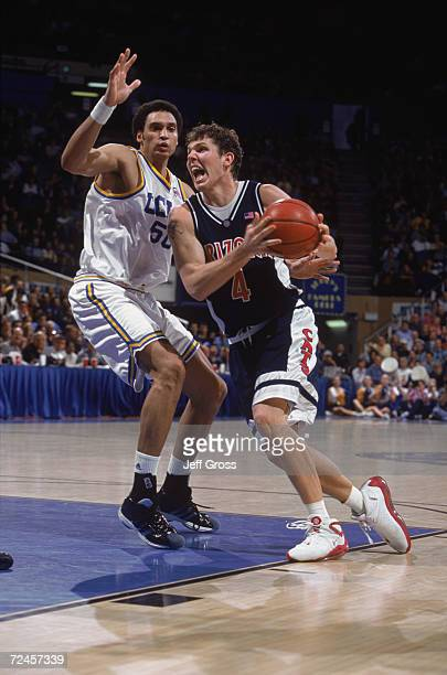 Forward Luke Walton of the Arizona Wildcats goes to the basket as center Dan Gadzuric of the UCLA Bruins plays defense during the Pac10 game at the...