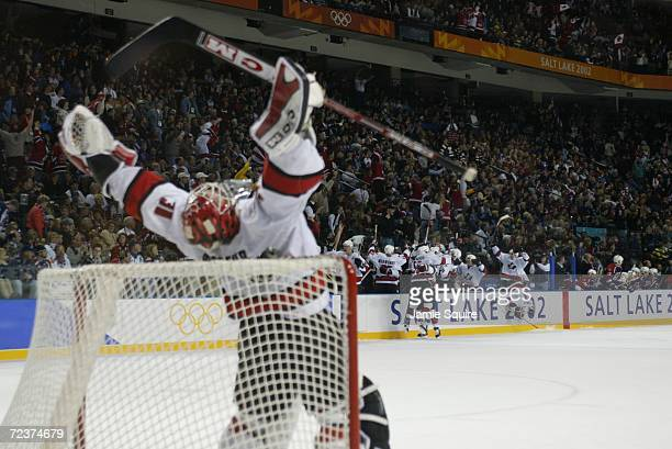 Goalie Martin Brodeur and the rest of the Canada team celebrate after defeating the USA 52 during the men's ice hockey gold medal game durng the Salt...