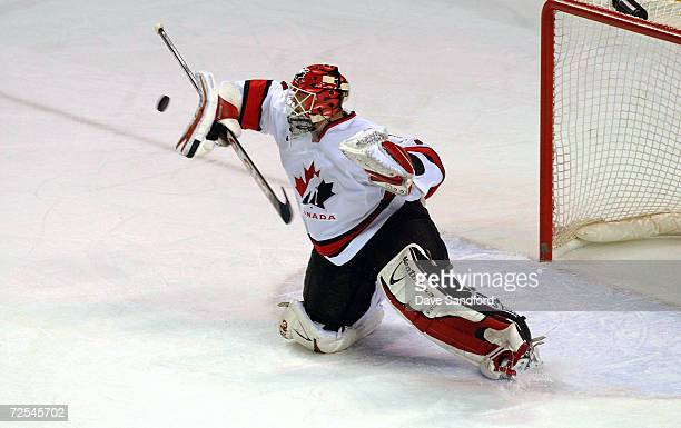 Goalkeeper Martin Brodeur of Canada stops the goal during the quarterfinal game against Finland at the Salt Lake City Winter Olympic at the E Center...