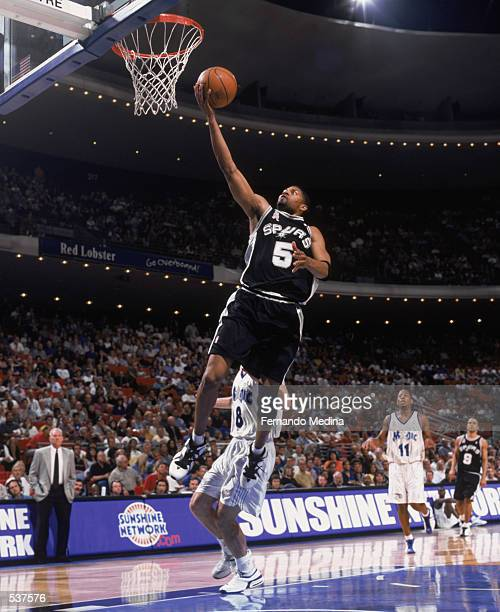 Guard Charles Smith of the San Antonio Spurs shoots a layup during the NBA game against the Orlando Magic at the TD Waterhouse Centre in Orlando...