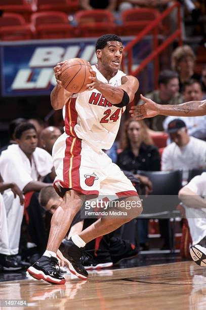 Guard Jim Jackson of the Miami Heat catches the ball during the NBA game against the San Antonio Spurs at American Airlines Arena in Miami Florida...