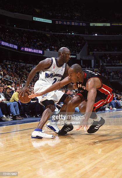 Guard Michael Jordan of the Washington Wizards fakes out forward LaPhonso Ellis of the Miami Heat during the NBA game at the MCI Center in Washington...