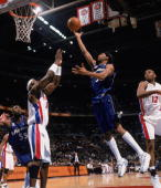 Guard Richard Hamilton of the Washington Wizards shoots over forward Ben Wallace of the Detroit Pistons during the NBA game at the Palace of Auburn...