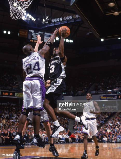 Guard Stephen Jackson of the San Antonio Spurs shoots over guard Bobby Jackson of the Sacramento Kings during the NBA game at Arco Arena in...