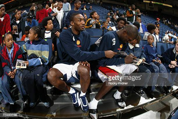 Guards Gilbert Arenas and Jason Richardson of the Golden State Warriors sign autographs before the NBA game against the Phoenix Suns at the Arena in...