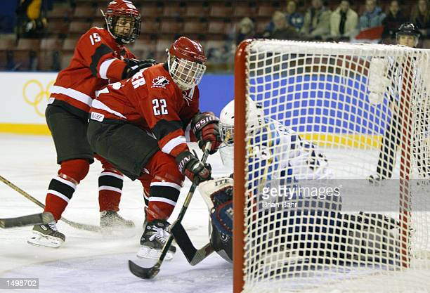 Hayley Wickenheiser of Canada flicks the puck off the end of her stick to score on goalie Natalya Trunova of Kazakhstan in the first period of their...