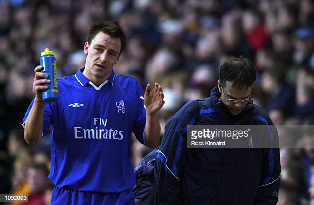 John Terry of Chelsea celebrates a hard earned point by clutching his Lucozade Sport drink after the FA Barclaycard Premiership match against Aston...