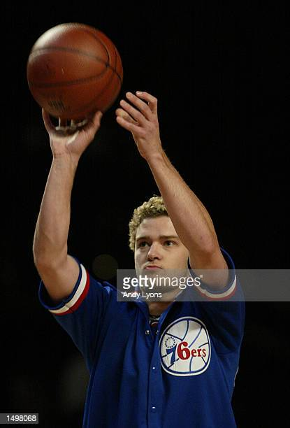 Justin Timberlake of ''N SYNC shoots the ball while warming up for the 989 Sports AllStar Hoop ItUp game during the NBA AllStar Weekend at the First...