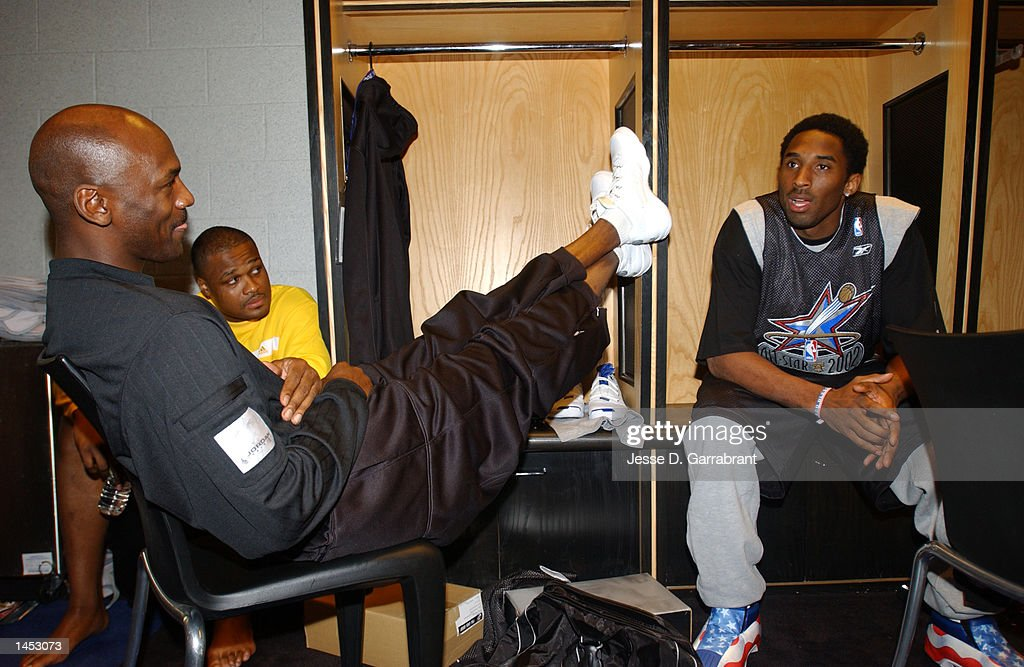 Kobe Bryant right of the West AllStar''s talks with Michael Jordan and Antoine Walker from the East Allstar''s before practice during AllStar weekend...