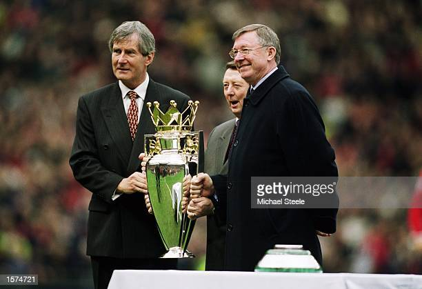 Manchester United chairman Martin Edwards and manager Alex Ferguson pose with the league title before the FA Barclaycard Premiership match against...