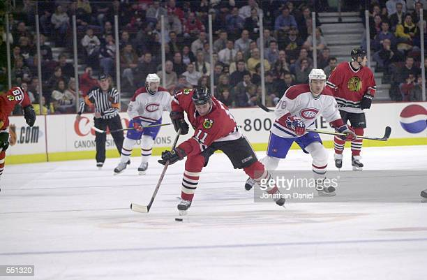 Peter White of the Chicago Blackhawks giudes the puck during the game against the Montreal Canadiens at United Center in Chicago Illinois The...