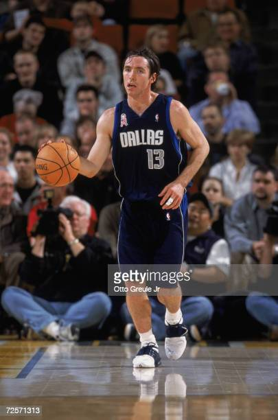 Point guard Steve Nash of the Dallas Mavericks dribbles the ball during the NBA game against the Seattle SuperSonics at the Key Arena in Seattle...