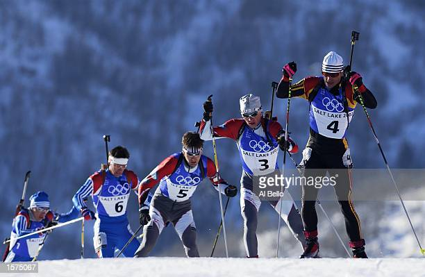 Ricco Gross of Germany leads to the finish in the men's 125km biathlon pursuit during the Salt Lake City Winter Olympic Games at Soldier's Hollow in...