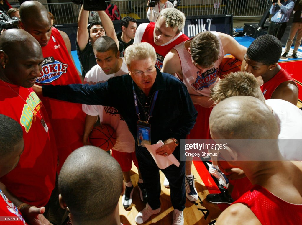 Rookie team head coach Chuck Daly talks with his team during their practice time at the NBA Jam Session Center Court in Philadelphia Pennsylvania...