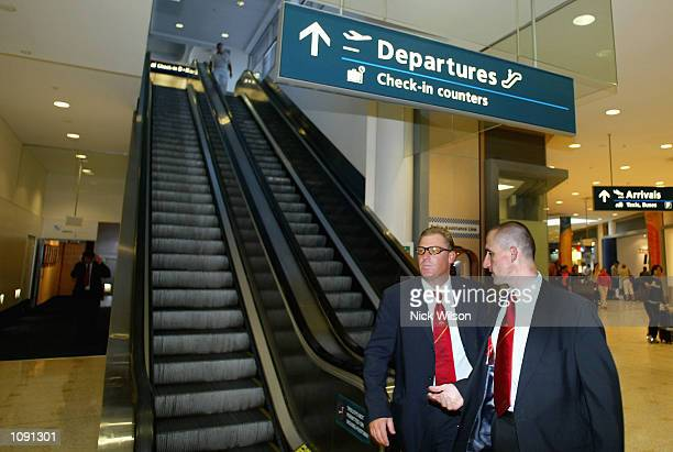 Shane Warne of Australia walks with ACB Media Manager Brian Murgatroyd to a press conference at Sydney Airport prior to the Australia Cricket Team...