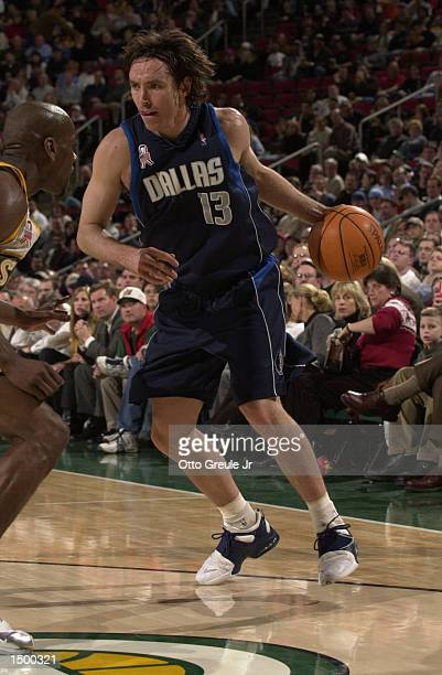 Steve Nash of the Dallas Mavericks drives against Gary Payton of the Seattle Supersonics at Key Arena in Seattle Washington The Mavericks defeated...