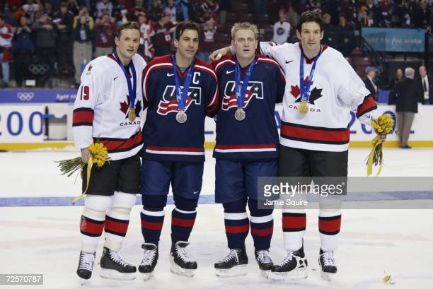 Steve Yzerman of Canada Chris Chelios of the USA Brett Hull of the USA and Brendan Shanahan of Canada pose with their medals after the mens ice...