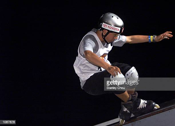 Takeshi Yasutoko of Japan in action during the Men's Inline Skating Street finals at the 2002 Asian XGames and Junior XGames Qualifier held at KLCC...