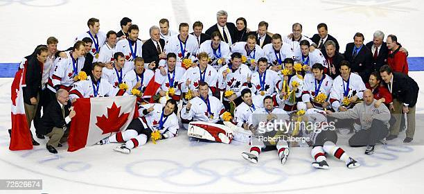 Team Canada poses for a team photo after winning the men's ice hockey gold medal game 52 over the USA of the Salt Lake City Winter Olympic at the E...
