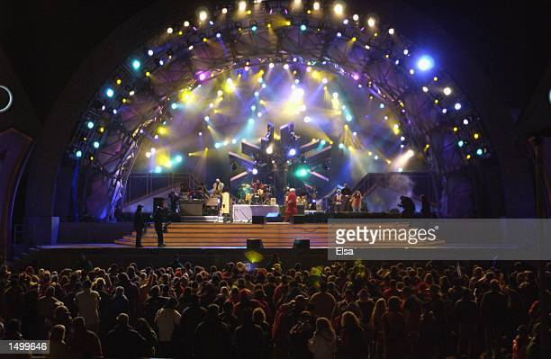 The crowd watches RB singers Macy Gray and George Clinton perform on stage at the Olympic Medals Plaza during the Salt Lake City Winter Olympic Games...
