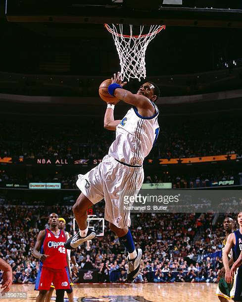 Tracy McGrady#1 of the Orlando Magic goes up for the monster dunk during the 2002 NBA All Star Game at the First Union Center in Philadelphia...