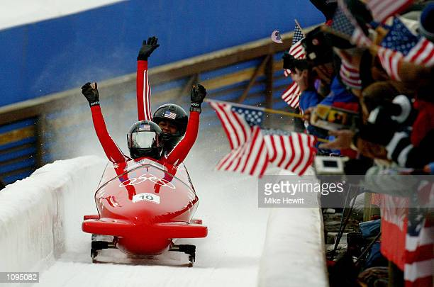 USA 2 Jill Bakken and Vonetta Flowers celebrate after leading after the first run in the women's 2woman bobsled during the Salt Lake City Winter...