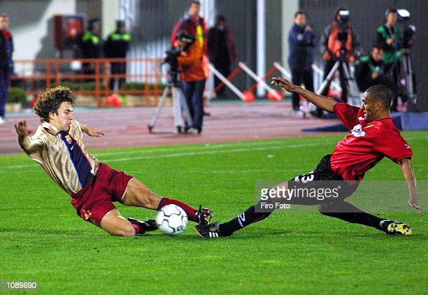 Vincente Engonga of Real Mallorca and Carlos Puyol of Barcelona in action during the Primera Liga match between Real Mallorca and Barcelona played at...