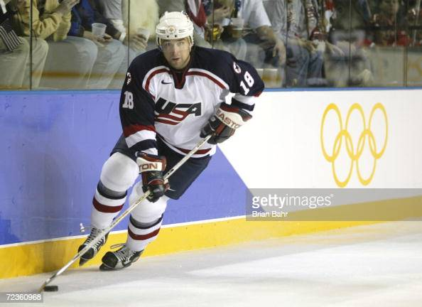 Chris Drury of the USA plays the puck along the boards against Belarus during the Salt Lake City Winter Olympic Games at the E Center in Salt Lake...