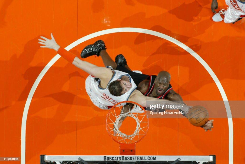 Feb 23, 2006; Charlotte, NC, USA; Portland Trailblazers RUBEN PATTERSON, against Charlotte Bobcats PRIMOZ BREZEC at the Charlotte Bobcats. The Blazers won 91-83.