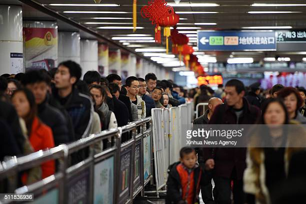 Passengers queue up for subways at Beijing West Railway Station in Beijing capital of China Feb 23 2016 Beijing saw a passenger return peak after the...